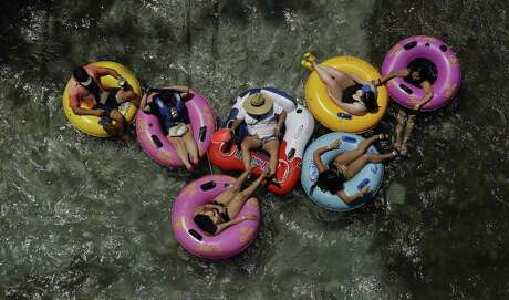 Tubers float on the cool Comal River as temperatures near triple digit numbers on a June day this year in New Braunfels. (AP Photo/Eric Gay)