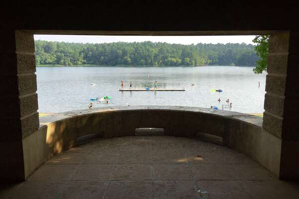 A view of the swimming beach through one of the picnic pavilions at Tyler State Park.