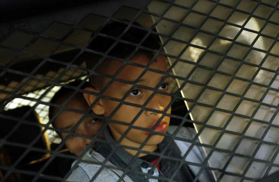 A young boy is detained along with his family members in Texas in May. Not just Republicans have an ugly record on immigration policy. The Democrats do as well. Photo: Carolyn Cole /TNS / Los Angeles Times
