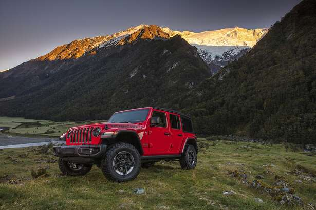This undated photo provided by Fiat Chrysler shows the 2018 Jeep Wrangler. The Wrangler is a two- or four-door SUV designed to be highly capable off-road and offer a wide variety of customization possibilities. (Courtesy of Fiat Chrysler Automobiles North America via AP)