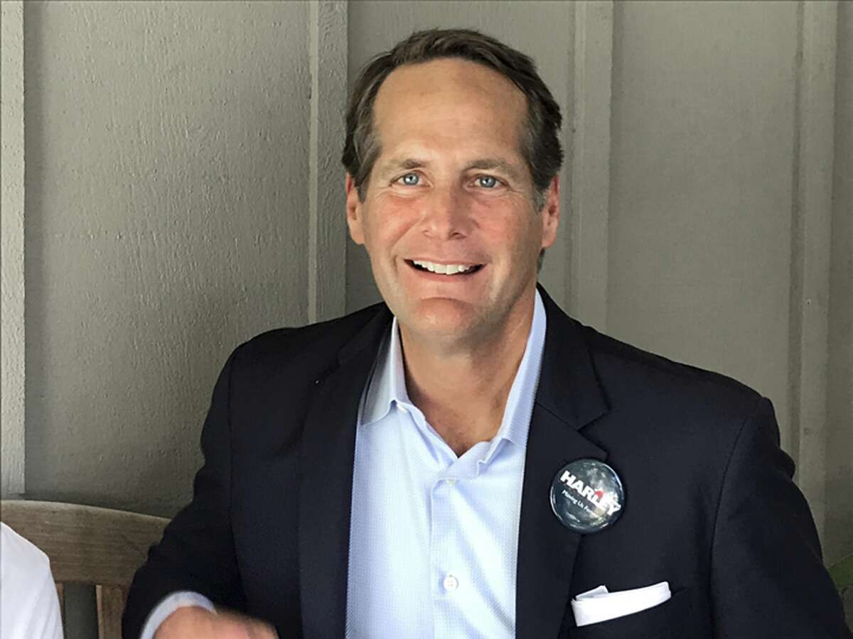 Harley Rouda, a Democratic candidate for Congress in the 48th District in Orange County, poses during interviews outside of a phone bank in Newport Beach, Calif., Tuesday, June 5, 2018. (AP Photo/Krysta Fauria)