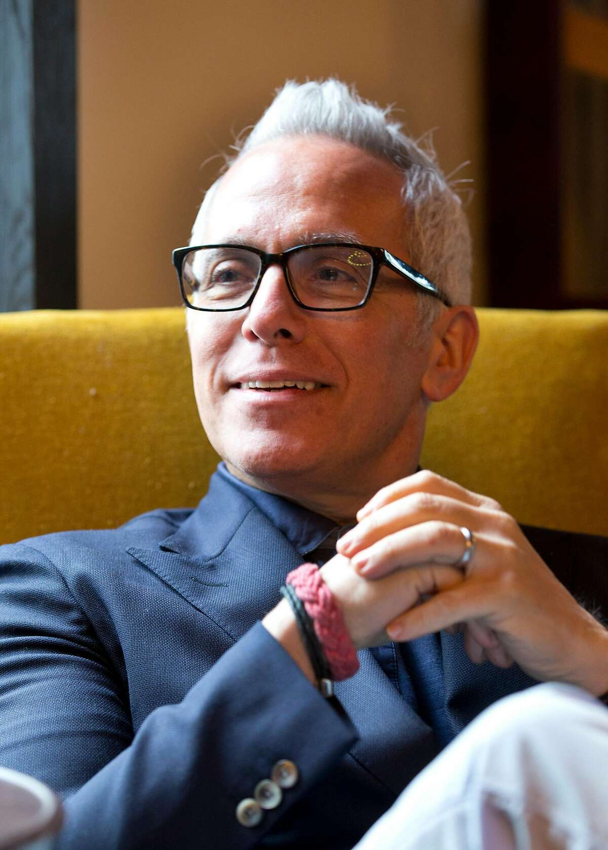 """Chef Geoffrey Zakarian listens to a question during an interview with The Associated Press, Friday, Feb. 20, 2015, in Miami Beach, Fla. Now honored with an Iron Chef title, a judging seat on """"Chopped"""" and a best-selling cookbook, Zakarian says opening a restaurant is a lot like playing poker. """"It's a crap shoot. We gamble when we open a restaurant,"""" said Zakarian, whose restaurants include The Lambs Club and The National. (AP Photo/Wilfredo Lee)"""