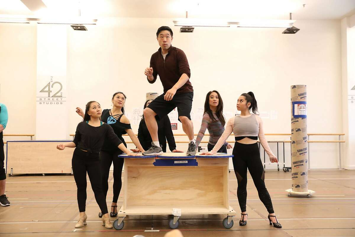 Clockwise from left: Cast members Kendyl Ito, Kristen Faith Oei, Maria-Christina Oliveras (obscured), Raymond J. Lee, Jaygee Macapugay and Geena Quintos in rehearsal for the upcoming premiere of David Henry Hwang and Jeanine Tesori�s �Soft Power� at the Curran. Directed by Leigh Silverman and choreographed by Sam Pinkleton, �Soft Power� runs June 20 through July 8, 2018. Photo by Joan Marcus. Photographed at New 42nd Street Studios.