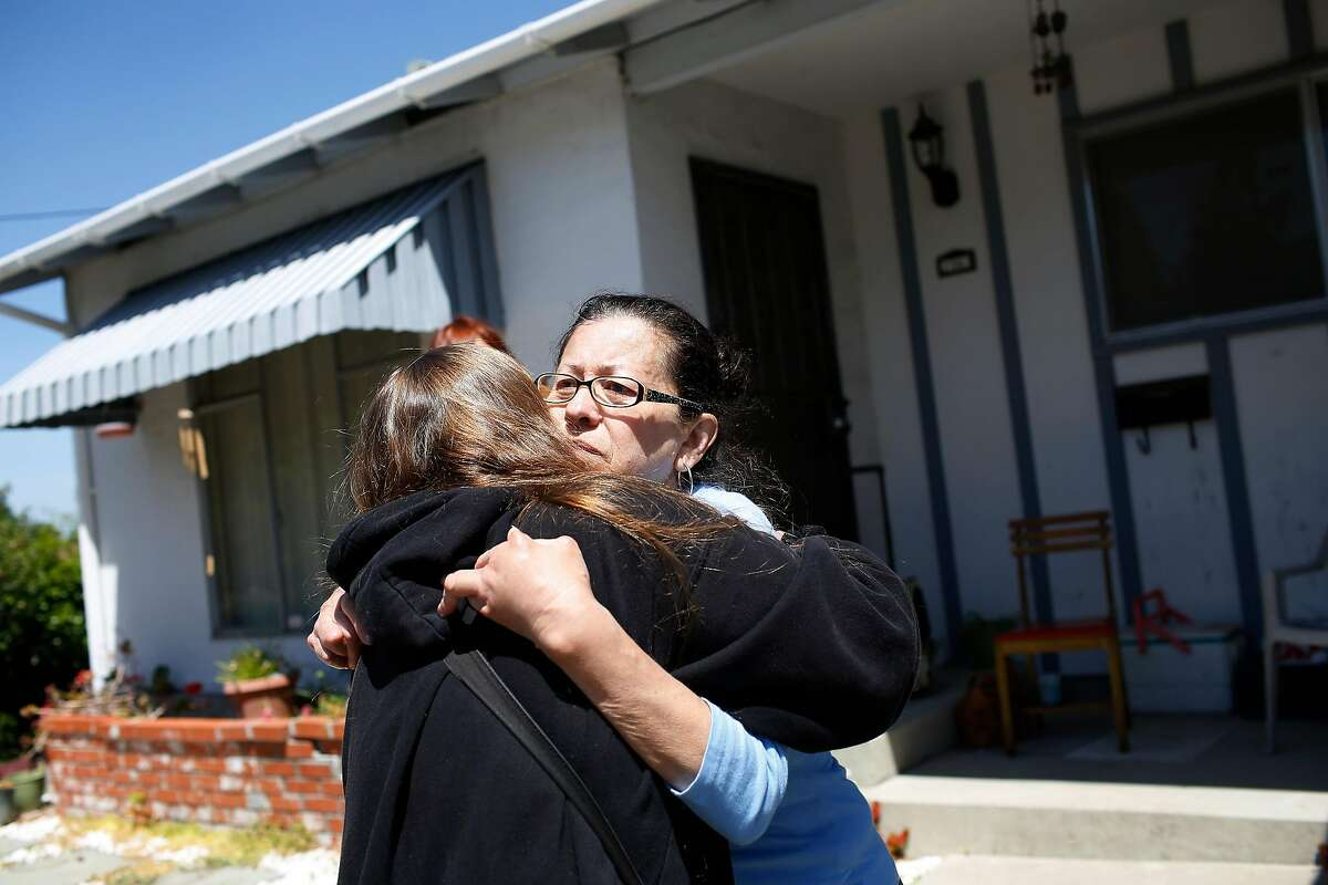 Genny Zentella (right) and Deanna Tucker (left), of San Pablo, hug in front of the home that Zentella bought in 1998 and was removed from earlier in the morning on Tuesday, June 5, 2018 in San Pablo, Calif. A stay of execution had expired at 6 a.m. the day before. Tucker said she lost her home in 2012 when her home went into foreclosure.