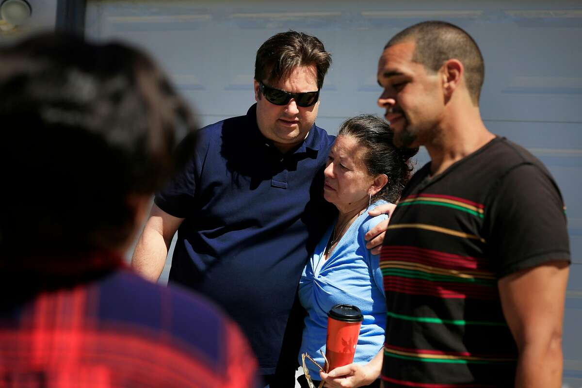 David Sharples (second from left), with Alliance of Californians for Community Empowerment, hugs Genny Zentella as they stand in front of the home she pruchased in 1998 and was removed from earlier in the morning on Tuesday, June 5, 2018 in San Pablo, Calif. A stay of execution had expired at 6 a.m. the day before.