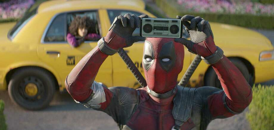 "This image released by Twentieth Century Fox shows Ryan Reynolds in a scene from ""Deadpool 2."" Photo: Twentieth Century Fox / Associated Press / TM & © 2018 Twentieth Century Fox Film Corporation.  All Rights Reserved.  Not for sale or duplication."