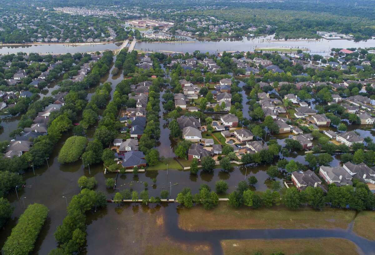 Homeowners who flooded during Hurrricane Harvey but had flood insurance received far more money to rebuild than neighbors who relied solely on FEMA assistance. The Canyon Gate neighborhood of Cinco Ranch (on right) was among the inundated neighborhoods.