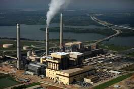 President Trump has ordered Energy Secretary Rick Perry to prepare steps that would keep coal and nuclear plants from shutting down. CPS Energy's coal plants Spruce 2, left, Spruce 1, center, and Deely are seen on Calaveras Lake near San Antonio.