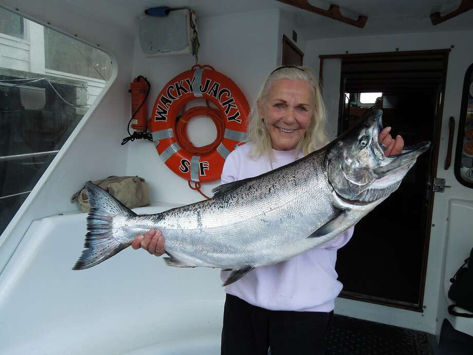 Jacqueline Douglas, captain of the Wacky Jacky out of San Francisco's Fishermen's Wharf, here with a big salmon, is ready to start her 47th year as a professional salmon skipper out the Golden Gate with the season opener on Sunday, June 17, 2018. Photo: Brian Murphy / Brian Murphy