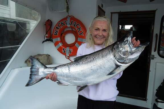 Jacqueline Douglas, captain of the Wacky Jacky out of San Francisco's Fishermen's Wharf, here with a big salmon, is ready to start her 47th year as a professional salmon skipper out the Golden Gate with the season opener on Sunday, June 17, 2018.