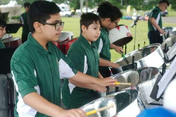 Park View Intermediate Steel Drum Band members Jesus Cortez, Uziel Valle and Luis Monteagudo perform.