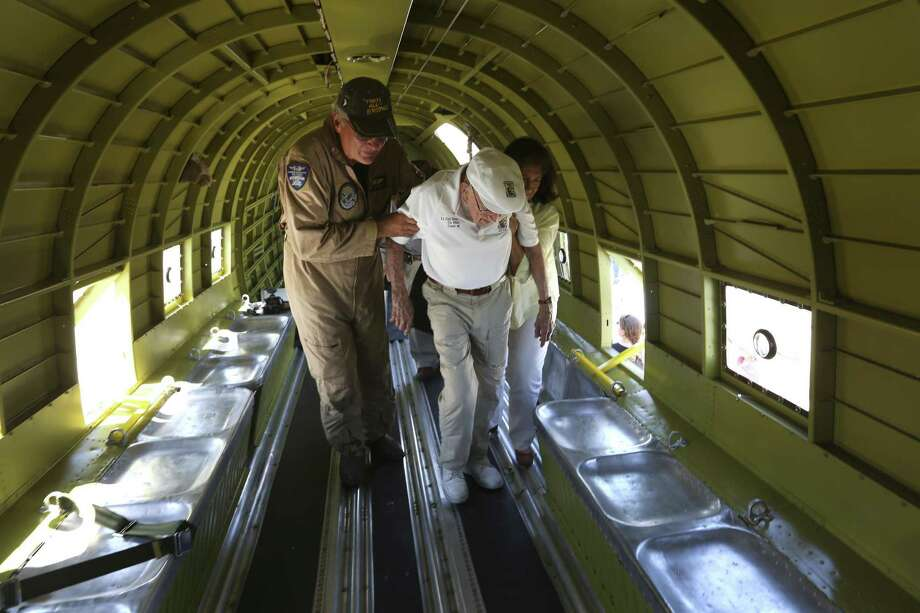 "Richard ""Dick"" Cole, the last surviving member of the famed World War II Doolittle Tokyo Raiders, is help Wednesday, June 6, 2018 to a seat in a C-47 cargo plane at the Commemorative Air Force's San Marcos facility as part of the organization's D-Day ceremonies. The recently-restored and now San Marcos-based C-47, nicknamed That's All Brother, was the lead aircraft across the English Channel on D-Day. The CAF is making plans to fly the aircraft to England in 2019 to take part in the 75th anniversary of the event. Photo: William Luther, Staff / San Antonio Express-News / © 2018 San Antonio Express-News"