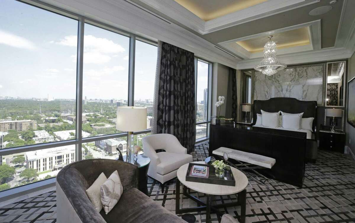 The master bedroom has a console that holds back-to-back TVs so you can watch different shows from the sofa or the bed.