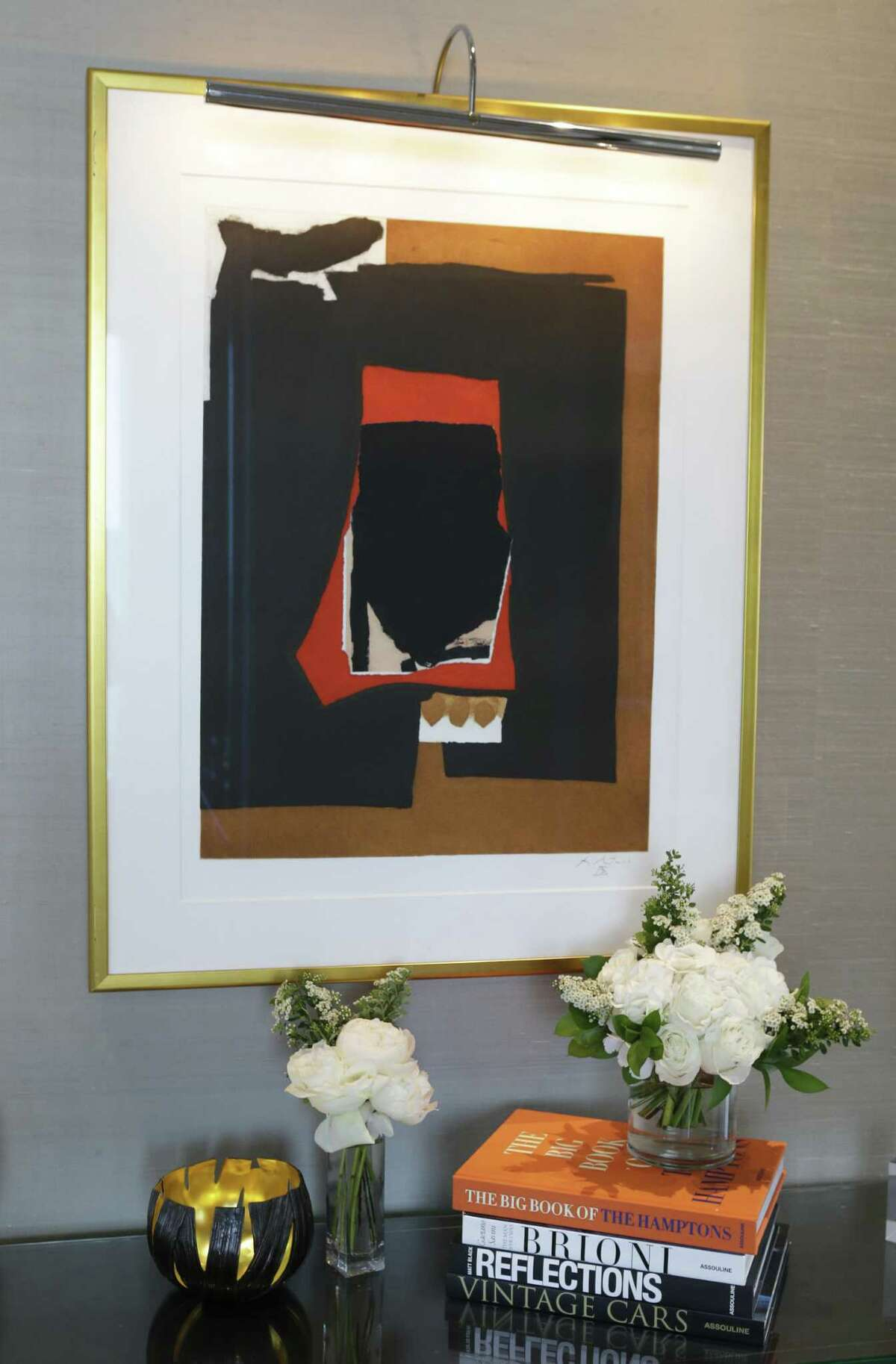 Tilman Fertitta filled his new hotel with museum-quality original art. The Presidential Suite has two pieces by 20th century abstract expressionist Robert Motherwell.