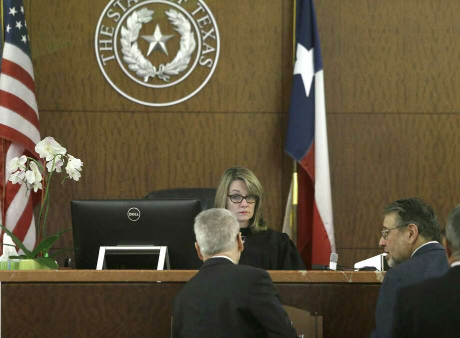 State District Judge Stacey Bond speaks with attorneys in the 176th State District Court at the Harris County Criminal Courthouse, 1201 Franklin, Monday, Dec. 7, 2015, in Houston. Bond, who is now a lawyer in private practice, is appealing her sanction by the State Commission on Judicial Conduct this month over the jailing of a witness in a rape trial. ( Melissa Phillip / Houston Chronicle ) Photo: Melissa Phillip,  Staff / Houston Chronicle / © 2015 Houston Chronicle