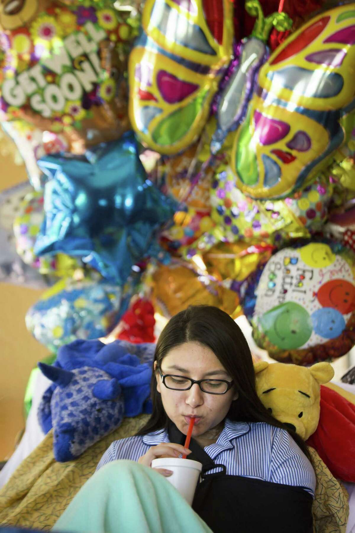 For several weeks, Santa Fe High School student Sarah Salazar will have a liquid diet until her fractured jaw is healed. Salazar was shot during a shooting at her high school and is recuperating from a shattered shoulder, a broken jaw and ribs. ( Marie D. De Jesus / Houston Chronicle )