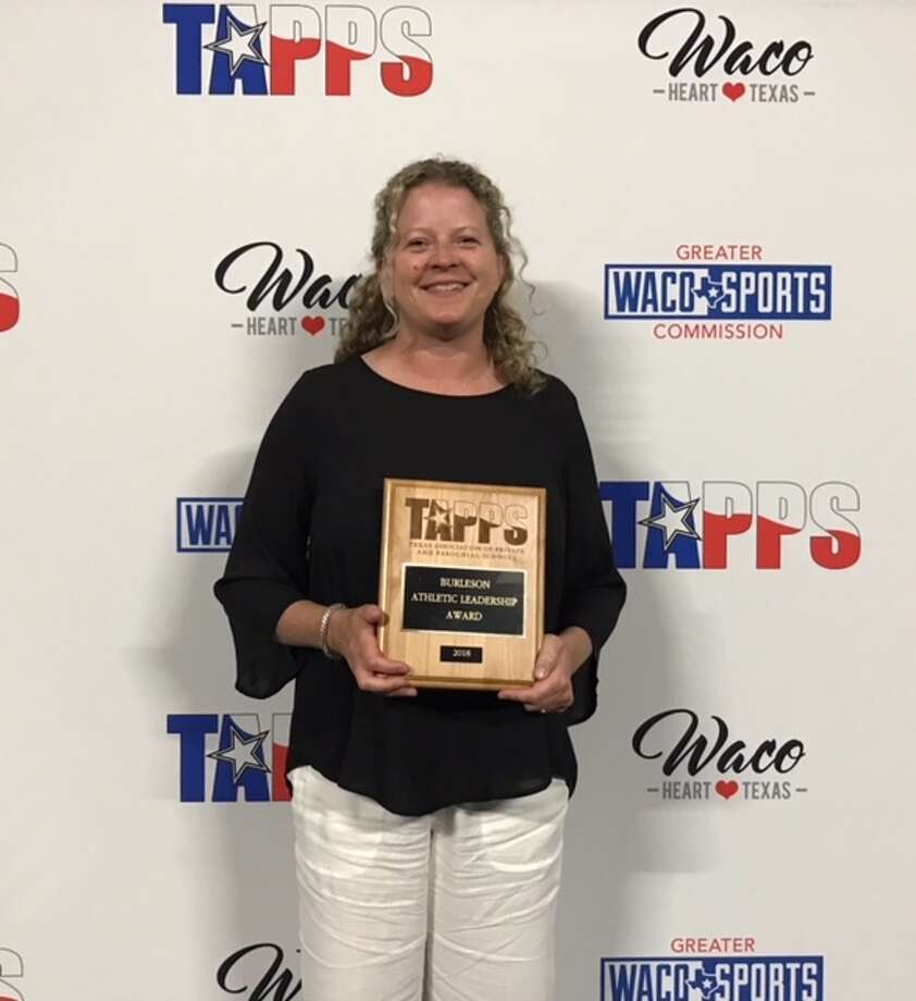 MCA girls basketball coach Carla Cunneen poses with the Burleson Athletic Leadership Award, Wednesday at the TAPPS Convention in Waco. Courtesy photo.