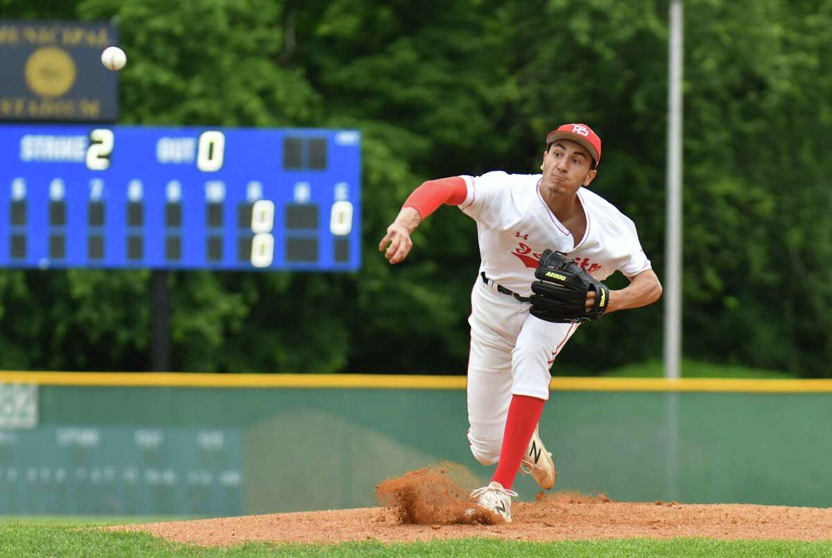 Starting pitcher Adam Stone (25) of the Fairfield Prep Jesuits delivers a pitch during the Class LL baseball semifinal round against the Cheshire Rams on Wednesday June 6, 2018, at Municipal Stadium in Waterbury, Connecticut.