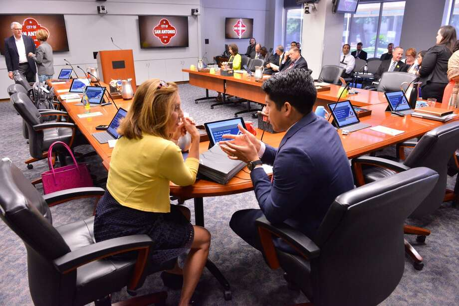 """City Council members Shirley Gonzales and Rey Saldana talk prior to a discussion on the council consideration of """"Innovation Zones"""" during a Wednesday meeting at. Photo: Robin Jerstad, Freelance"""