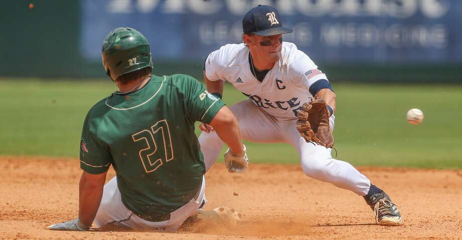 UAB infielder Thomas Johns (27) beats the tag by Rice infielder Ford Proctor (8) during action at Reckling Park Sunday, May 13, 2018, in Houston. ( Steve Gonzales / Houston Chronicle ) Photo: Steve Gonzales/Houston Chronicle