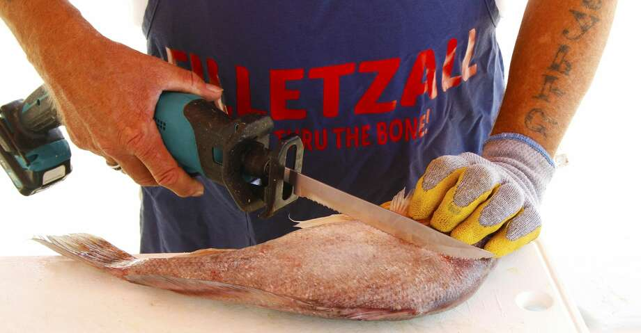 Designed to fit hand-held reciprocating saws, Filletzall blades developed by Houston-area charterboat captain Paul Bates give anglers frustrated with limitations of regular electric fillet knives a supercharged option for cleaning their catch. Photo: Shannon Tompkins/Houston Chronicle