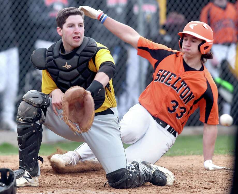 Amity catcher Pat Winkel waits for the throw as Matt Hunyadi of Shelton scores in the fifth inning in Woodbridge on April 30, 2018. Photo: Arnold Gold / Hearst Connecticut Media / New Haven Register