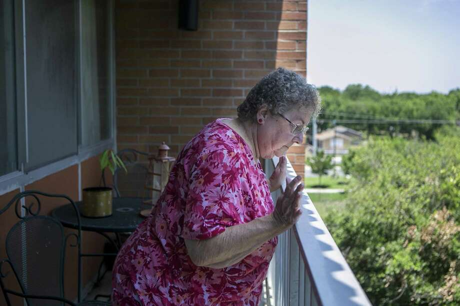 Sharon Samples, 69, checks out the view from her fifth-floor patio at Laurel Plaza Apartments in New Braunfels. Samples has lived at the complex for more than eight years and is concerned how U.S. Housing and Urban Development Secretary Ben Carson's proposed rent reforms may affect her and her neighbors. Photo: Josie Norris /San Antonio Express-News / © San Antonio Express-News