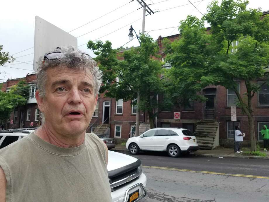 Jim Furlong, who lives on Lark Street in Sheridan Hollow, discusses the quality of life issues in his neighborhood, including problem sassociated with the X placards on vacant buildings. (Chris Churchill / Times Union)