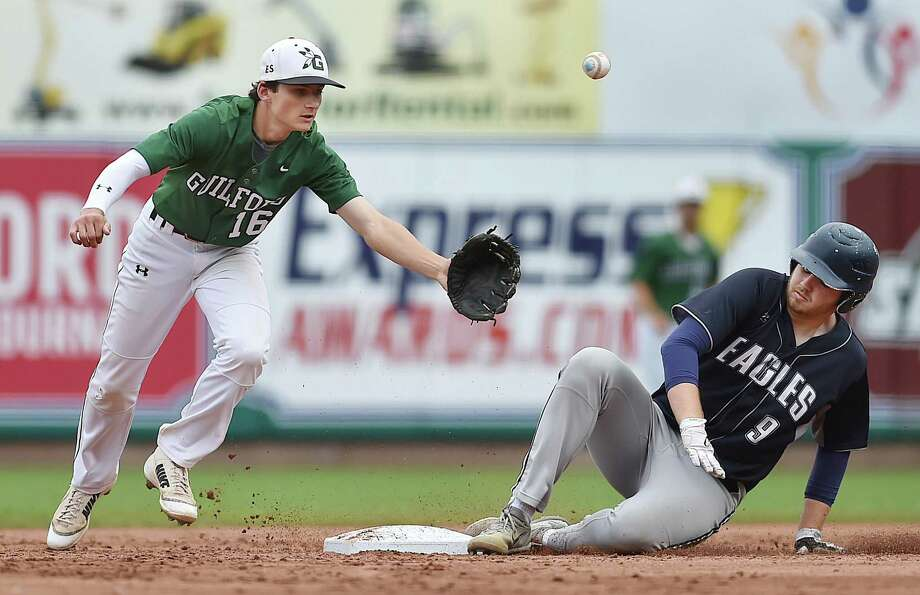 Wethersfield senior Timothy Blaisdell steals second as Guilford sophomore second baseman John Petonito looses control of the ball in the Class L state semifinals on Wednesday. Photo: Catherine Avalone / Hearst Connecticut Media / New Haven Register