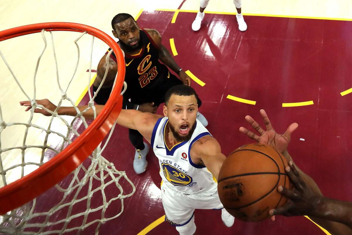 CLEVELAND, OH - JUNE 06: Stephen Curry #30 of the Golden State Warriors reaches for a rebound against the Cleveland Cavaliers in the first quarter during Game Three of the 2018 NBA Finals at Quicken Loans Arena on June 6, 2018 in Cleveland, Ohio.