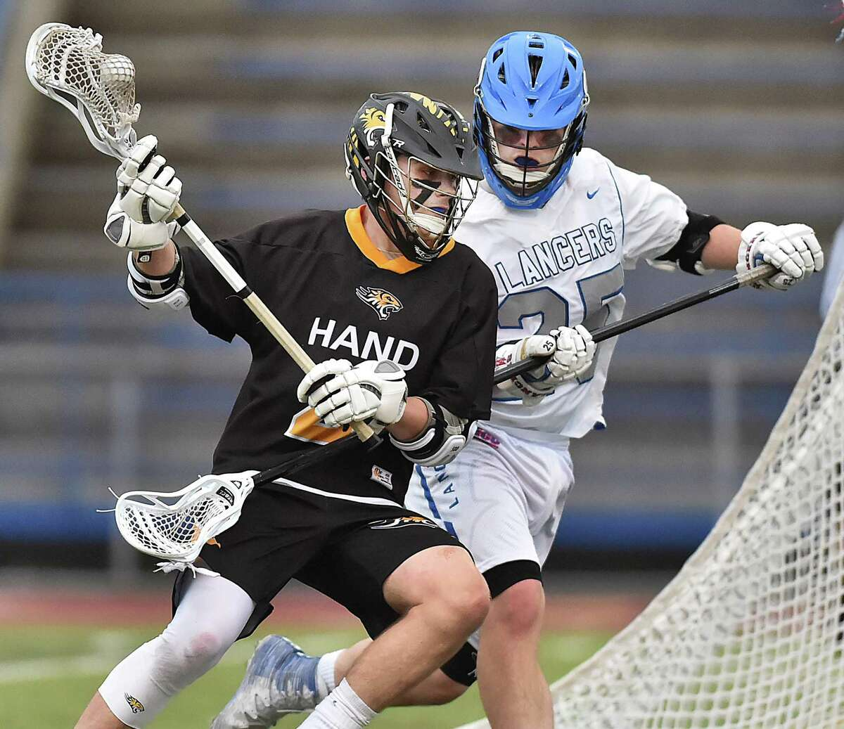 Hand junior Thomas Ferrick moves to the goal as Waterford senior Mackenzie Czyzewski defends during the Class M semifinals on Wednesday.