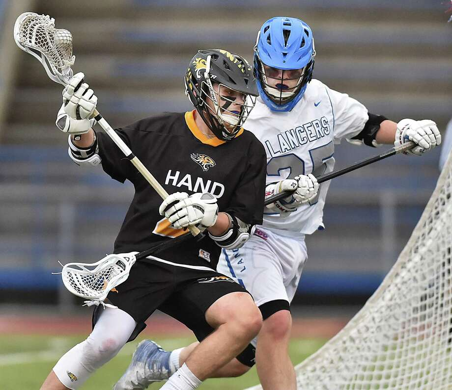 Hand junior Thomas Ferrick moves to the goal as Waterford senior Mackenzie Czyzewski defends during the Class M semifinals on Wednesday. Photo: Catherine Avalone / / New Haven RegisterThe Middletown Press