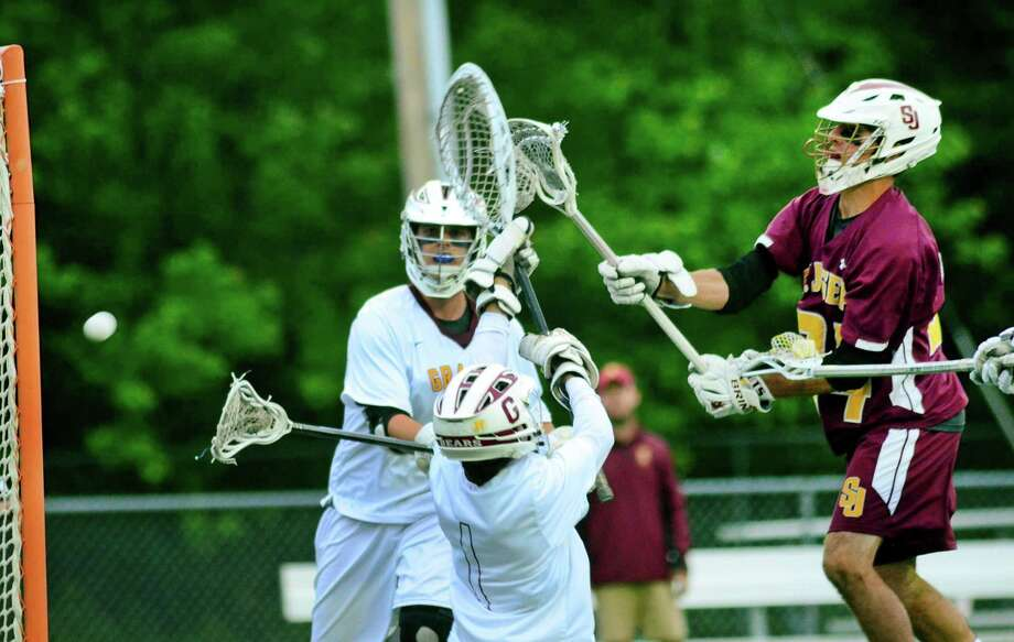St. Joseph's Jared Mallozzi (24) sends the ball past Granby's goalie Dan DeGagne (1) during Class S boys lacrosse semi-final action in Cheshire, Conn. on Wednesday June 6, 2018. Photo: Christian Abraham / Hearst Connecticut Media / Connecticut Post