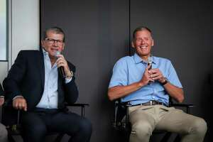 Geno Auriemma, left, and Randy Edsall participate in the UConn Coaches Road Show on Wednesday at Hearst Tower in New York City.