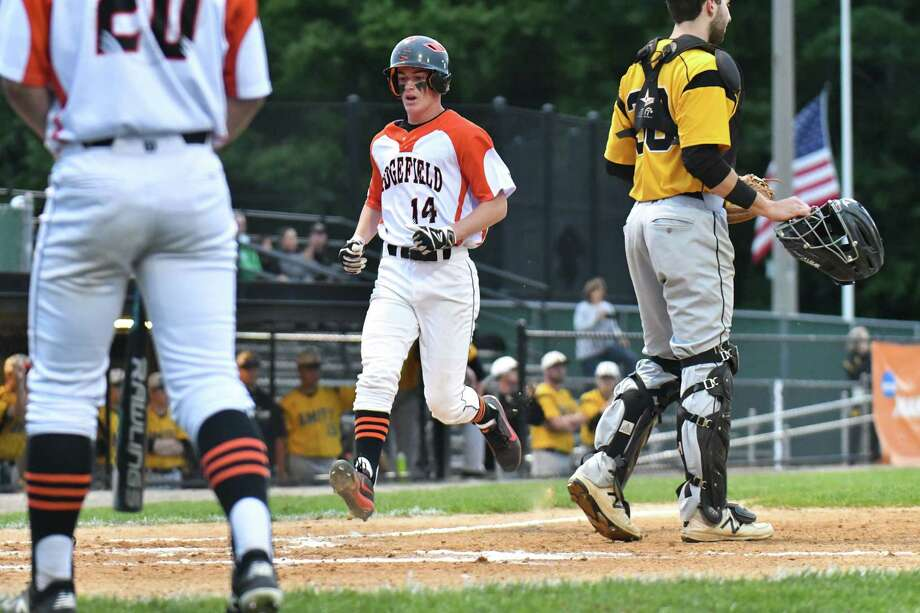 Matthew Stamatis (14) of the Ridgefield Tigers scores during the Class LL baseball semifinal round against the Amity Spartans on Wednesday June 6, 2018, at Municipal Stadium in Waterbury, Connecticut. Photo: Gregory Vasil / For Hearst Connecticut Media / Connecticut Post Freelance