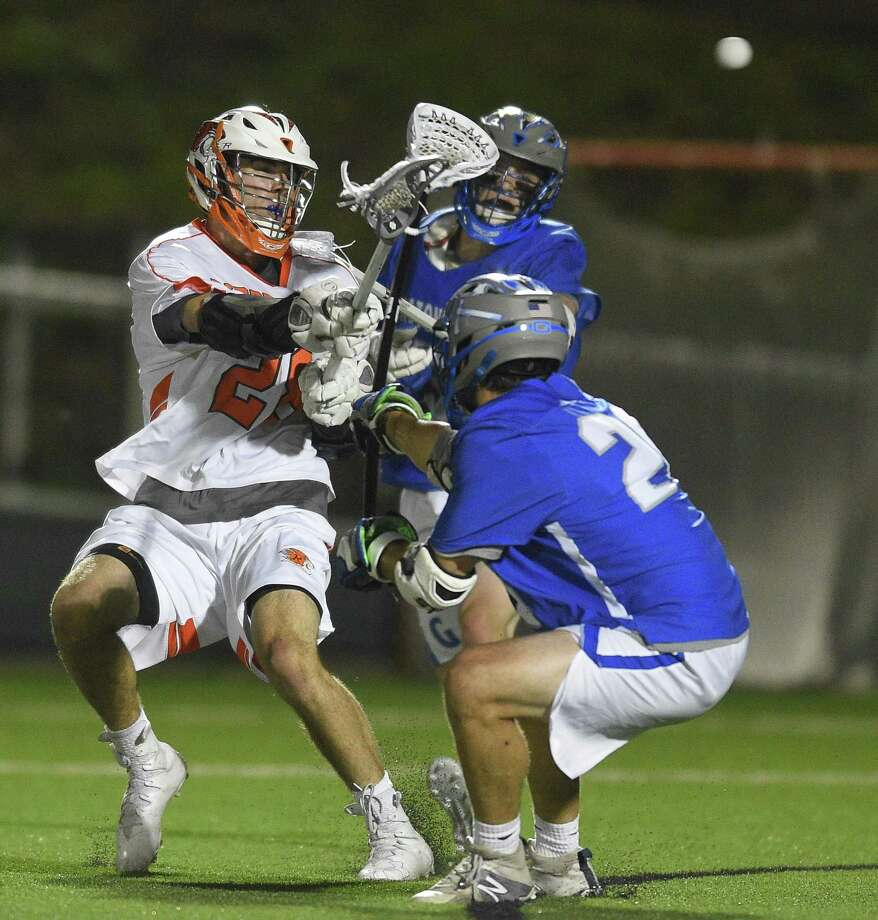 Ridgefield's Dawson Muller (28) pops in the game tying goal against Glastonbury in a CIAC Class L boys lacrosse semifinal contest at Fairfield University Conway Field at Rafferty Stadium on June 6, 2018 in Fairfield, Connecticut. Ridgefield defeated Glastonbury 6-5, to advance to Saturday's final against Darien. Photo: Matthew Brown / Hearst Connecticut Media / Stamford Advocate