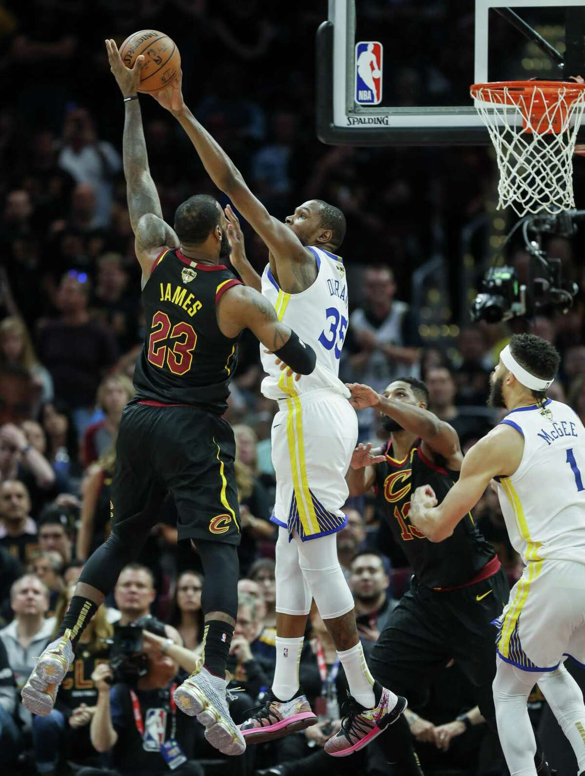 Golden State Warriors' Kevin Durant blocks a Cleveland Cavaliers' LeBron James shot in the third quarter during game 3 of The NBA Finals between the Golden State Warriors and the Cleveland Cavaliers at Oracle Arena on Wednesday, June 6, 2018 in Cleveland, Ohio.