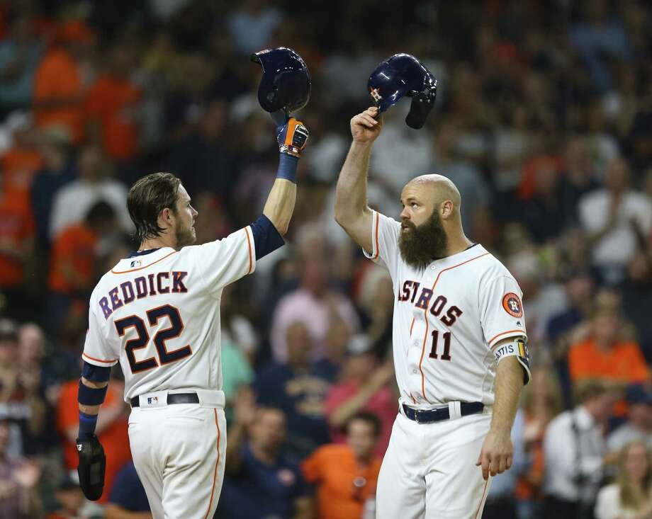 Josh Reddick, left, agrees it's hats off to Evan Gattis after the Astros' burly designated hitter blasted a two-run homer in the fourth inning Wednesday. Photo: Mark Mulligan, Houston Chronicle / Houston Chronicle / © 2018 Houston Chronicle