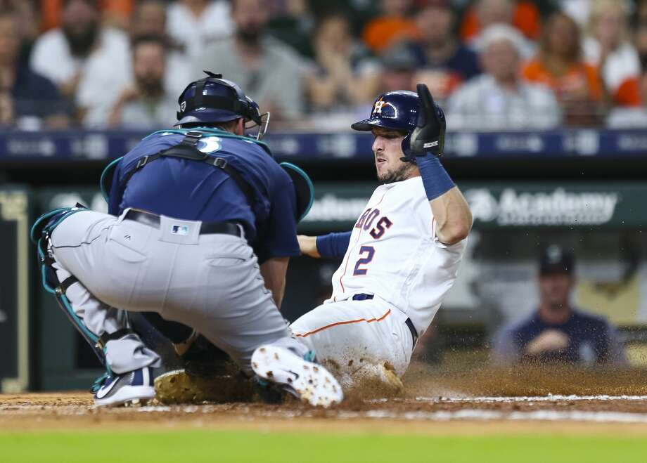 Houston Astros third baseman Alex Bregman (2) is tagged out by Seattle Mariners catcher Mike Zunino (3) during the third inning of an MLB game at Minute Maid Park, Wednesday, June 6, 2018, in Houston.  ( Mark Mulligan / Houston Chronicle ) Photo: Mark Mulligan/Houston Chronicle