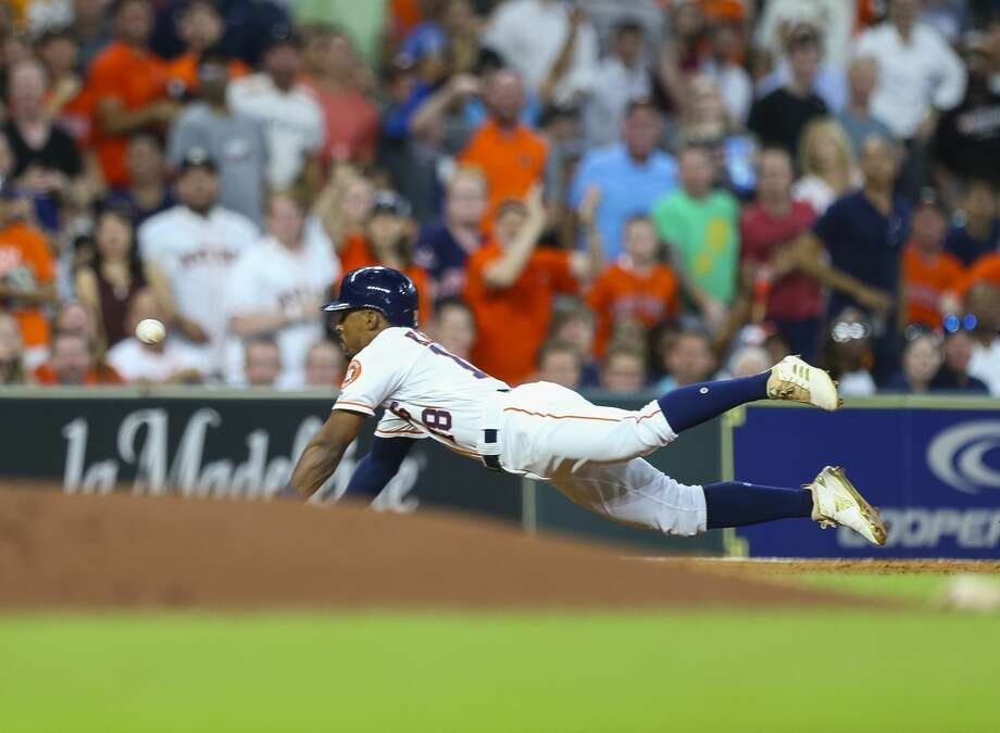Houston Astros second baseman Tony Kemp (18) tries to stretch for an extra base during the third inning of an MLB game at Minute Maid Park, Wednesday, June 6, 2018, in Houston. Kemp would be tagged out at third. ( Mark Mulligan / Houston Chronicle ) Photo: Mark Mulligan/Houston Chronicle