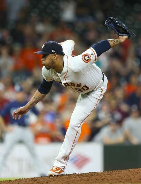 Houston Astros relief pitcher Hector Rondon (30) pitches during the ninth inning of a 7-5 win for the Astros at Minute Maid Park, Wednesday, June 6, 2018, in Houston.  ( Mark Mulligan / Houston Chronicle ) Photo: Mark Mulligan/Houston Chronicle
