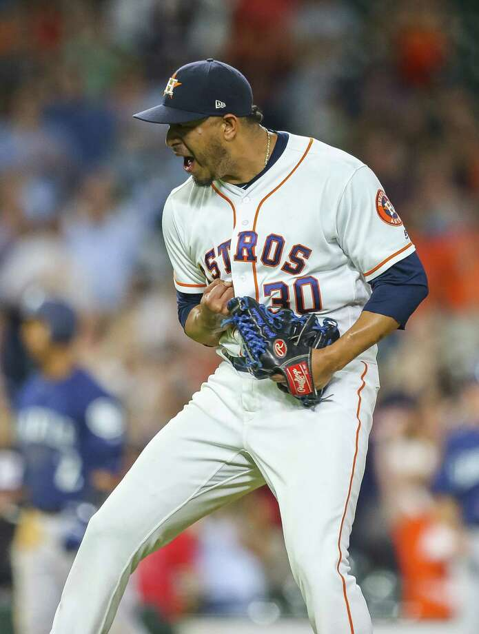 Hector Rondon has cause to celebrate after fanning Nelson Cruz with two on to close the Astros' 7-5 win. Photo: Mark Mulligan, Houston Chronicle / Houston Chronicle / © 2018 Houston Chronicle