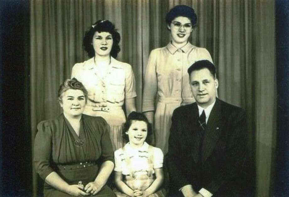 The Ella and James Reid family have a studio portrait taken. In the back, from left, are daughters Jane and Lois. In the front is Ella, Kay and James Reid. The family lived at 614 W. Main St. where Kay grew up, loving the house and neighborhood.