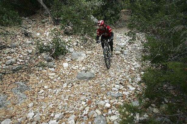 A parkgoer navigates through Wildcat Canyon Trail at Government Canyon State Natural Area.