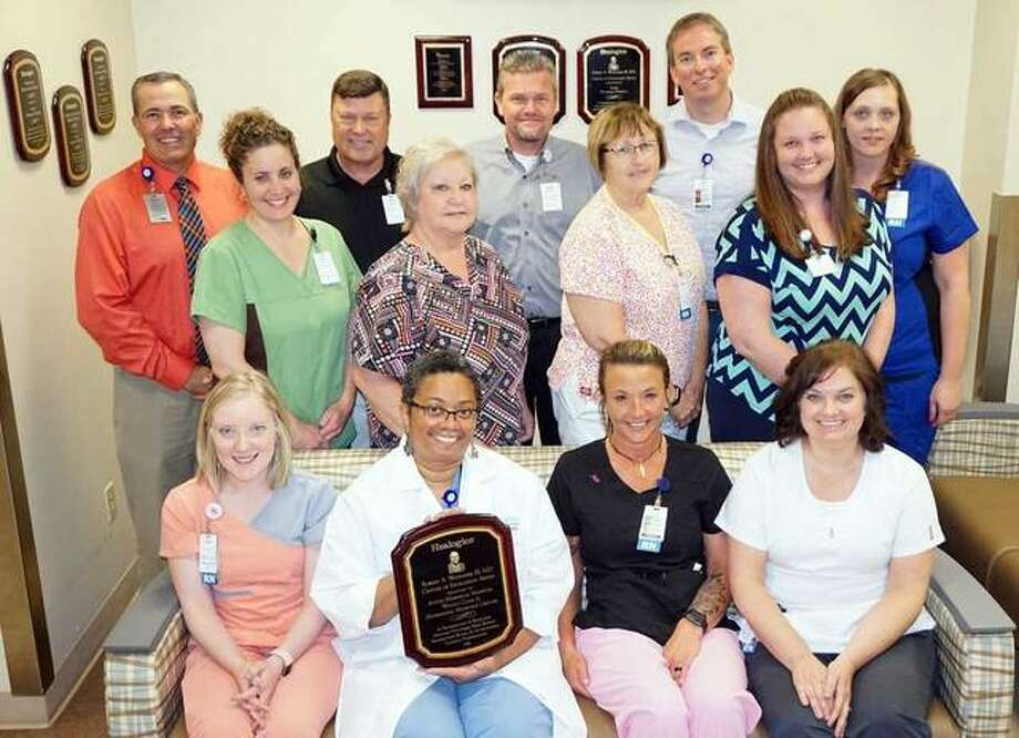 The AMH Center for Wound Care and Hyperbaric Medicine staff was congratulated by AMH leadership for earning another Center of Excellence Award. Staff includes, front row left to right, Katie Alexander, RN, Dr. Valinda Allen, medical director; Jera Connell, RN; Kathy Ridenhour, RN. Middle row left to right, Tonya Ballard safety director; Tammy Miller, front office coordinator; Bernice Smith, RN; Jana Lybarger, clinical nurse manager. Back row left to right, Rusty Ingram, AMH director of Business Development; AMH President Dave Braasch; Brad Goacher, AMH VP of Administration; Matt Flick director of the Wound Care Center; and Ashley Cline, RN. Photo:       For The Telegraph