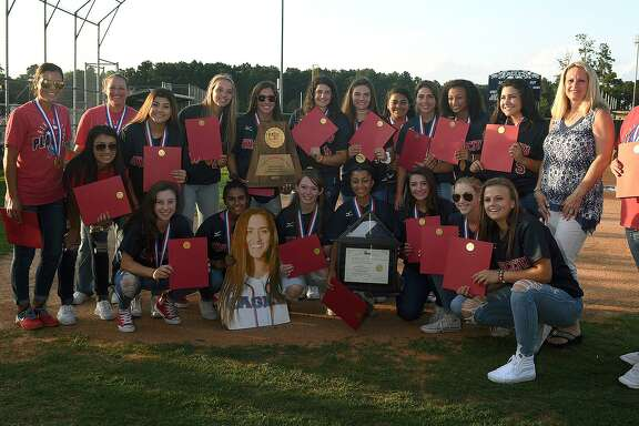 "The Atascocita Lady Eagles show off their Class 6A State Softball Championship trophy during the ""Bringing It Home"" Celebration held at the Atascocita High School softball field on June 5, 2018. (Jerry Baker/For the Chronicle)"