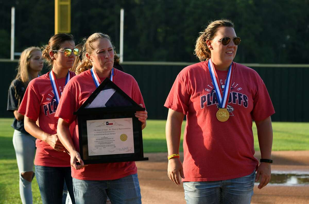 Atascocita Lady Eagles Head Softball Coach Ashley Boyd, from right, Asst. Coach Shamber Stapley, and Asst. Coach Alyssa Romero listen as Humble Mayor Pro-Tem Norman Funderburk officially congratulates the Lady Eagles on their winning the Class 6A State Softball Championship during the ?