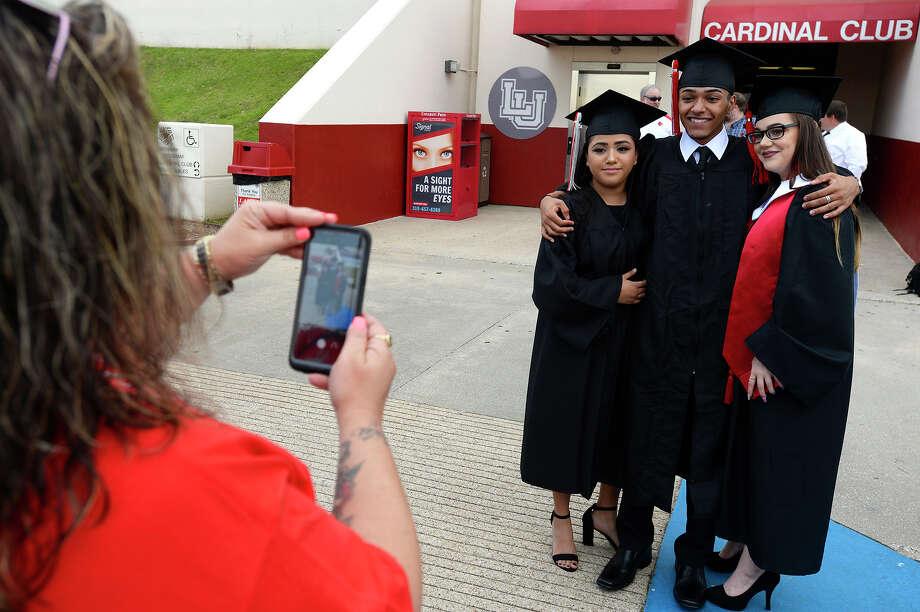 Daisy Sanchez, Edward Morgan and Katrina Portillo pose for a photo before Memorial's graduation ceremony at the Montagne Center. Photo taken Wednesday 6/6/18 Ryan Pelham/The Enterprise Photo: Ryan Pelham/The Enterprise / ?2018 The Beaumont Enterprise