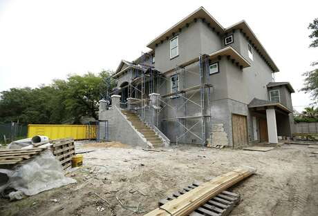 A new construction elevated house, built up by a homeowner after Harvey, along Brays Bayou during a tour of the area with housing analyst Scott Davis, Friday, April 20, 2018, in Houston. ( Karen Warren  / Houston Chronicle )