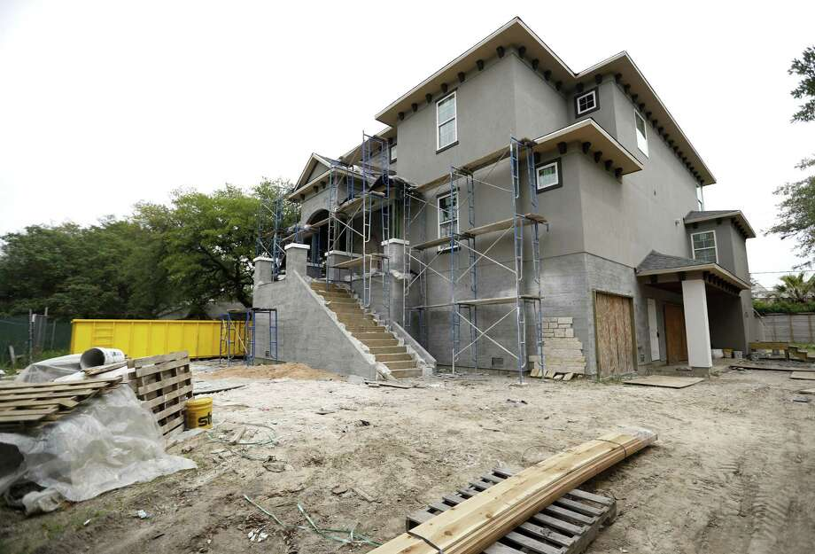 A new construction elevated house, built up by a homeowner after Harvey, along Brays Bayou during a tour of the area with housing analyst Scott Davis, Friday, April 20, 2018, in Houston. ( Karen Warren  / Houston Chronicle ) Photo: Karen Warren, Staff / Houston Chronicle / © 2018 Houston Chronicle